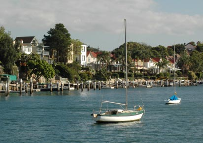 Shore of Sydney Harbour, with moorings and private jetties.